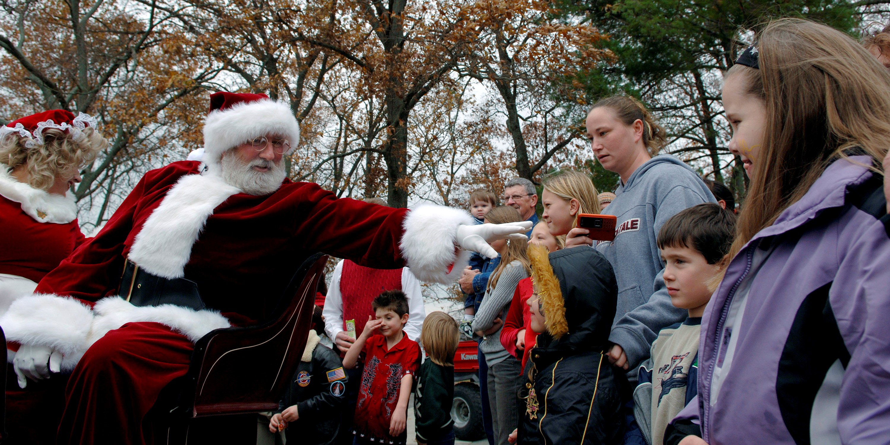 Santa reaches out and says hello to the kids of Arnold Air Force Base, Tenn., while making his way by sleigh to the Arnold Lakeside Club for a Christmas party, Dec. 2. (U.S. Air Force photo/Staff Sgt. Bennie J. Davis III)
